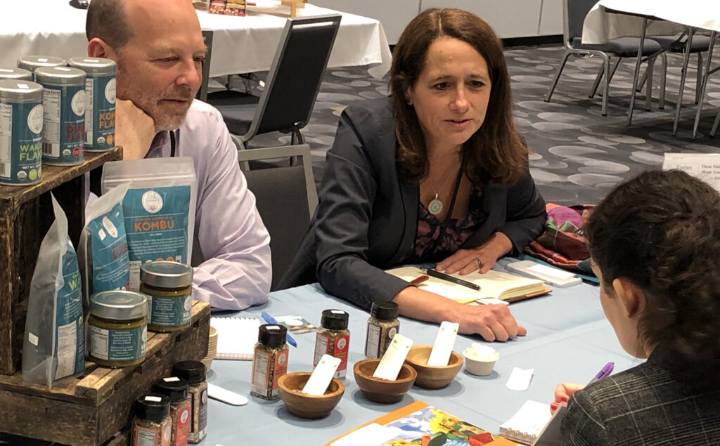 photo of people talking at a table at a trade show