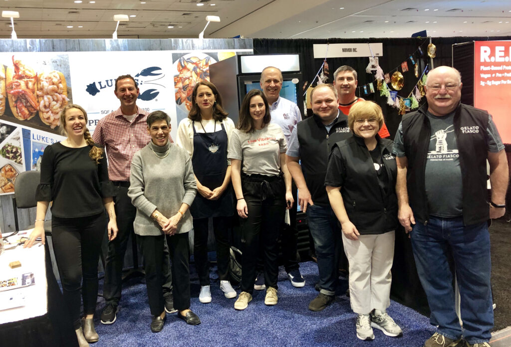 photo of a group of people at a trade show